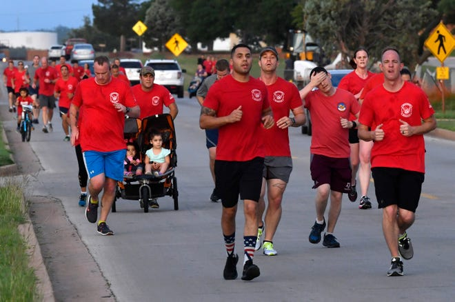 Dyess Air Force Base personnel and family members run down Avenue D on base Tuesday during the TORQE-62 memorial run. The sunrise 10-K run was organized by the 317th Airlift Wing and honored the victims of TORQE-62, the call sign of a C-130J that crashed in Afghanistan Oct. 2, 2015 with six airmen and five others aboard.