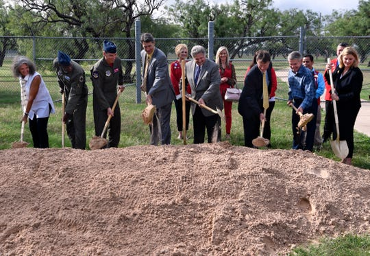 Lynda Otto (far left) ceremoniously shovels dirt with 7th Bomb Wing Commander Col. Brandon Parker, 317th Airlift Wing Commander Col. Jeff Menasco and other dignitaries during Tuesday's dedication for the Dyess Memorial Park Expansion.