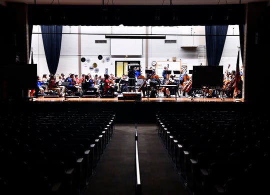 The Madison Middle School orchestra practices on stage in the school auditorium on Sept. 27. The orchestra does not have a rehearsal hall.