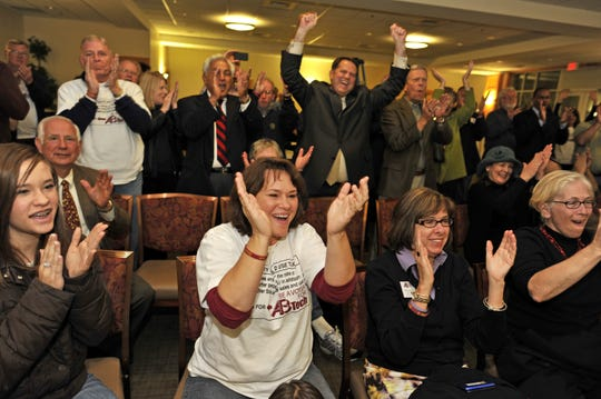Asheville-Buncombe Technical Community College supporters cheer Nov. 8, 2011, after finding out voters narrowly passed the quarter-cent sales tax referendum.