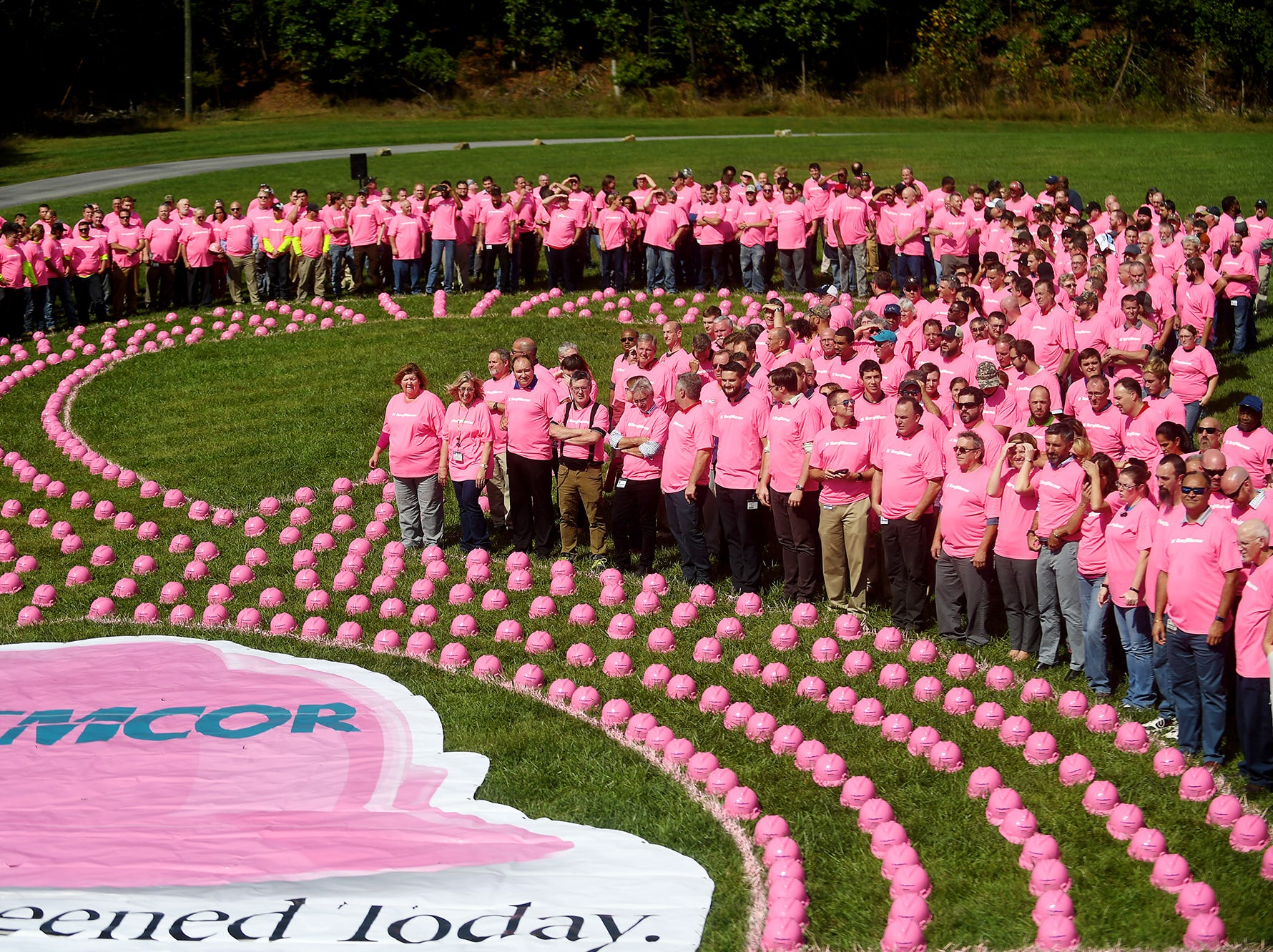 """EMCOR/Bahnson Mechanical Systems and 630 BorgWarner employees created a visual call to action with EMCOR's signature giant human pink hard hat ribbon for their """"Protect yourself. Get screened today."""" campaign Oct. 1, 2018 in Arden to kickoff Breast Cancer Awareness Month."""