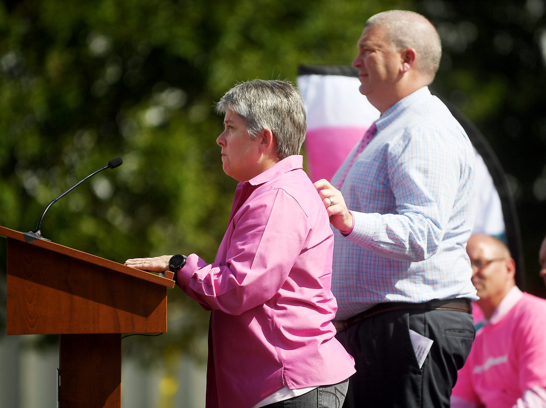 Hope Lineberry, a breast cancer survivor, speaks about her experience to 630 BorgWarner employees as her husband and Bahnson safety director, Danny, comforts her Oct. 1, 2018.