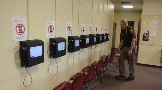 Chief Deputy Randy Hazel checks some of the 10 video stations at the Calhoun County jail.