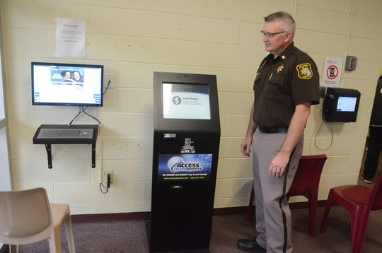 Chief Deputy Randy Hazel as the registration station for the video system at the Calhoun County jail.
