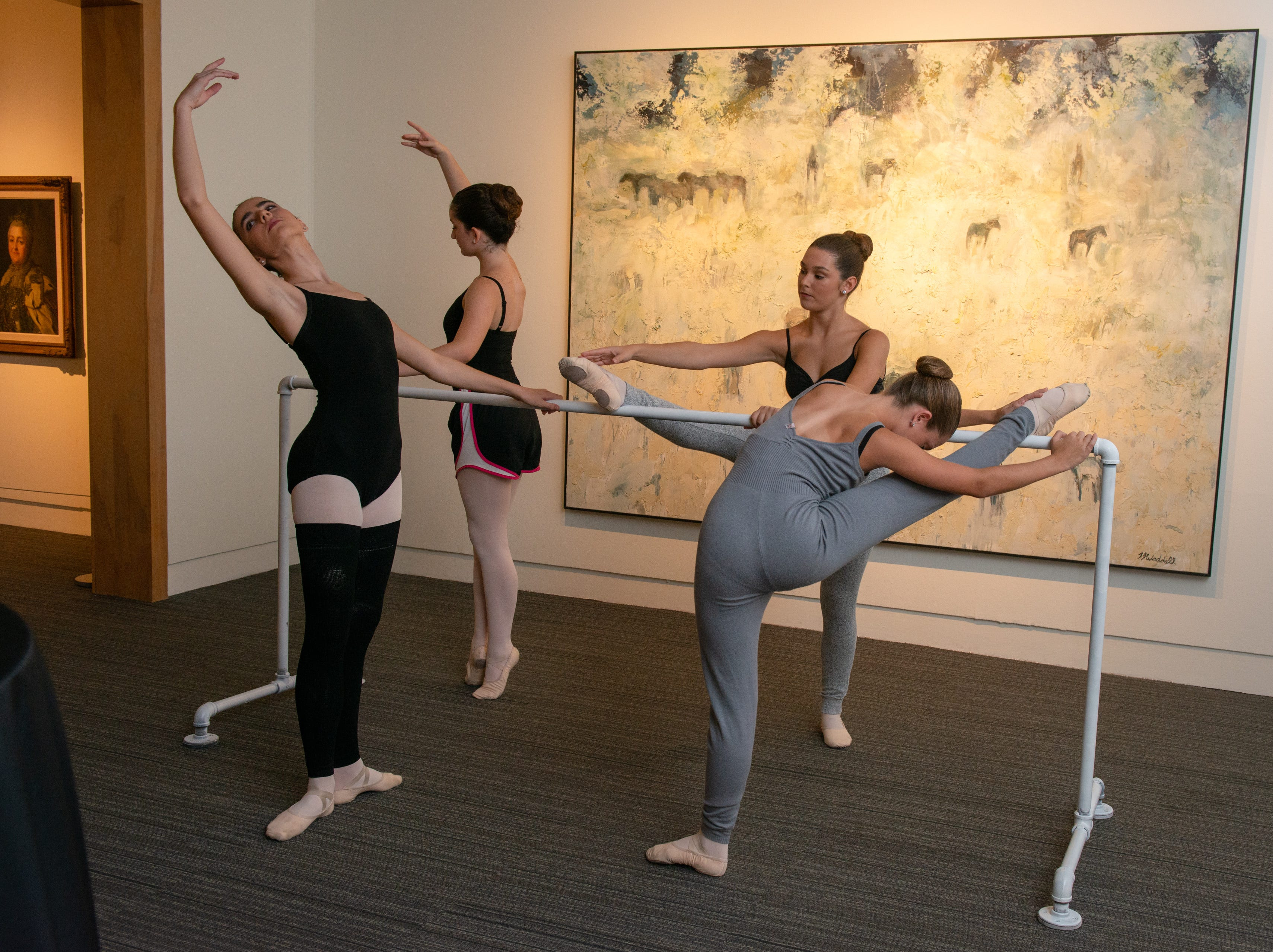 "Ballerinas warm up before a performance during an ""Evening of Arts"" at the Foosaner Art Museum."