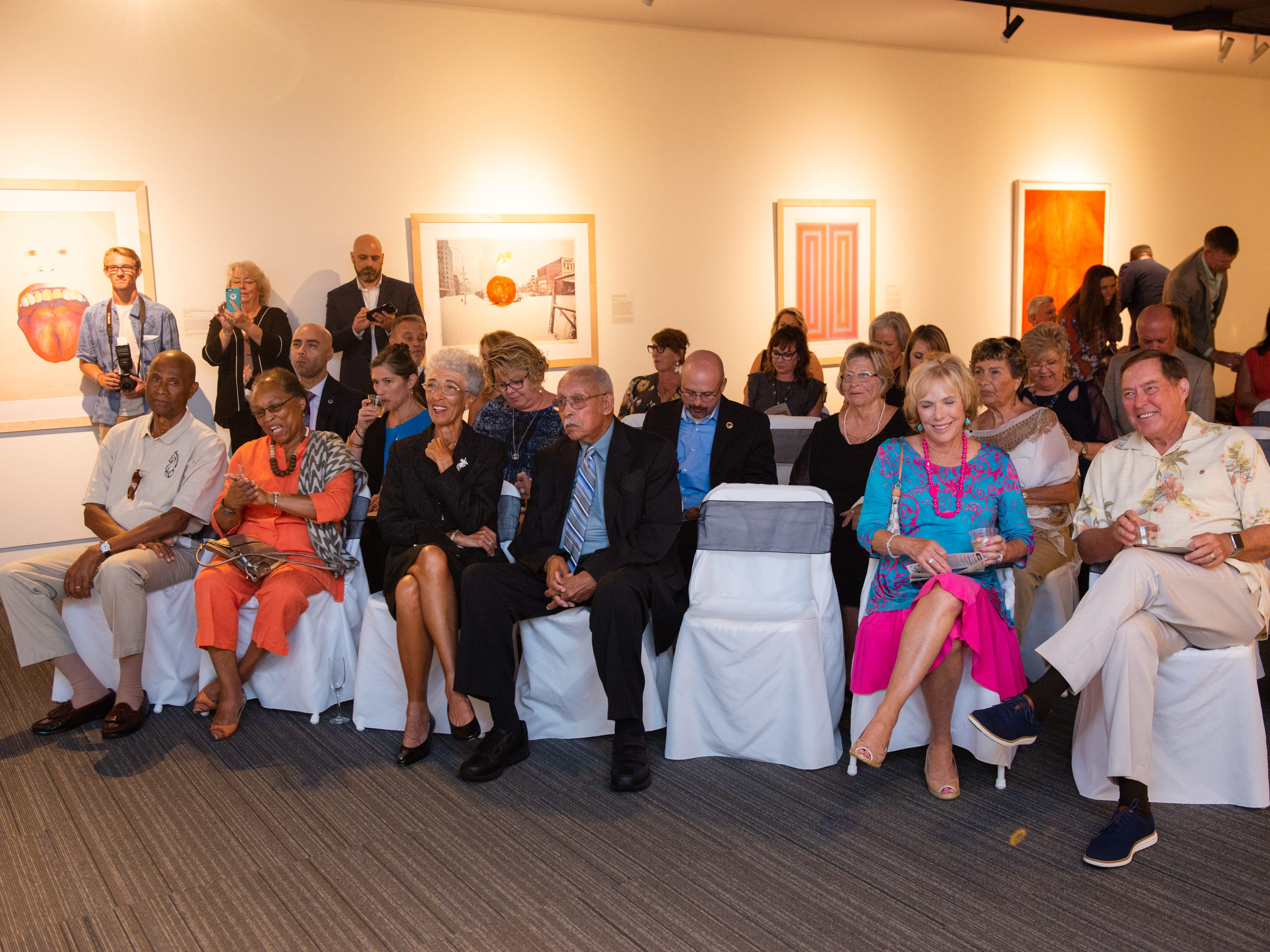 "Guests listen to opening remarks during an ""Evening of Arts"" at the Foosaner Art Museum."