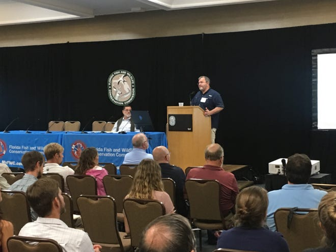 William F. Patterson III, an ecologist from University of Florida, speaks Tuesday at the Florida Fish and Wildlife Conservation Commission's Lionfish Summit in Cocoa Beach.