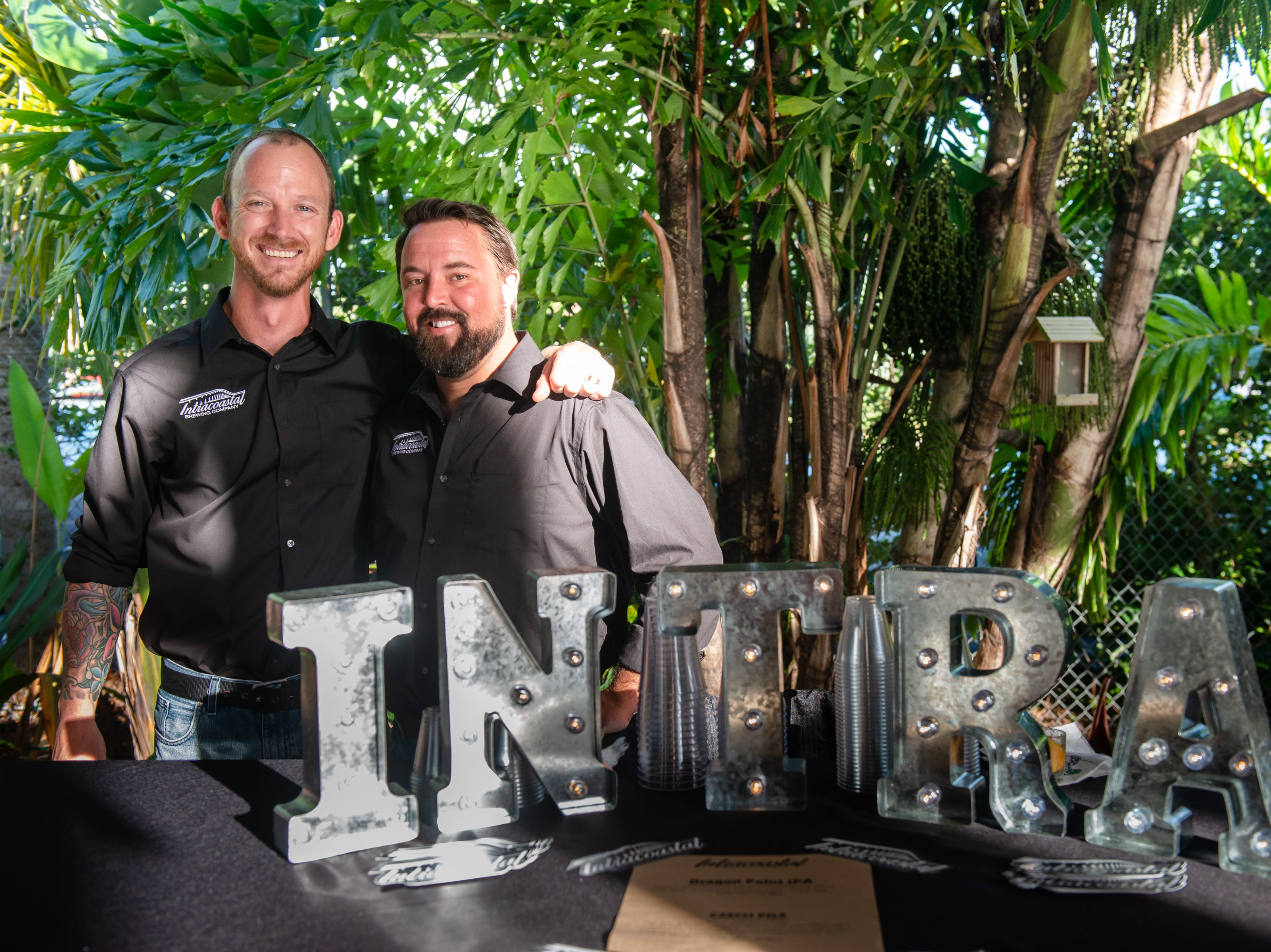 Kyle Smyth and John Curtis of Intracoastal Brewing Company at the James Beard Foundation Celebrity Chef Dinner held at the Brevard Zoo. (Photo by Amanda Stratford, for FLORIDA TODAY)