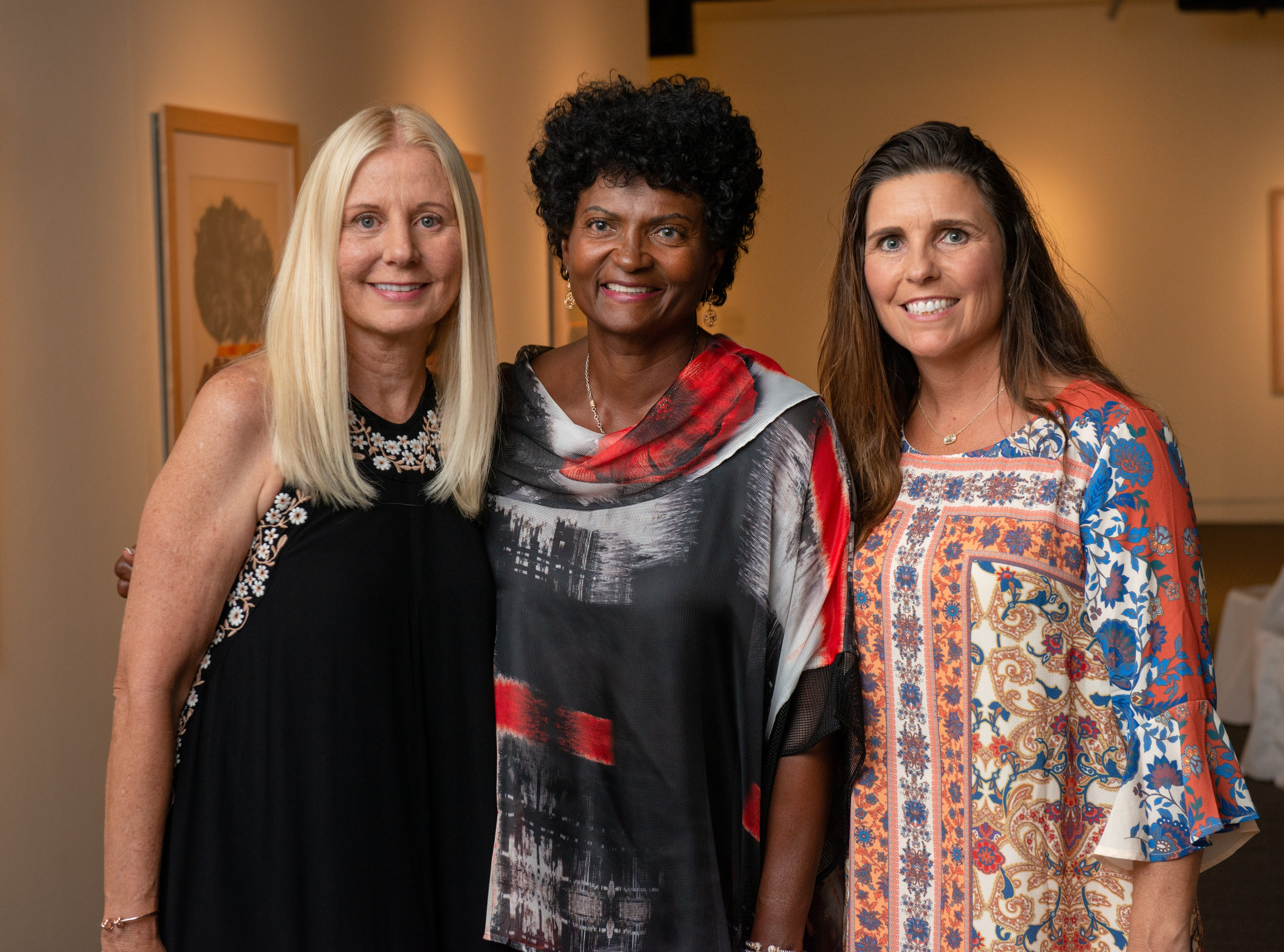 "Loretta Grella Sorbello, Marilyn Scott and Michelle Robinson during an ""Evening of Arts"" at the Foosaner Art Museum."