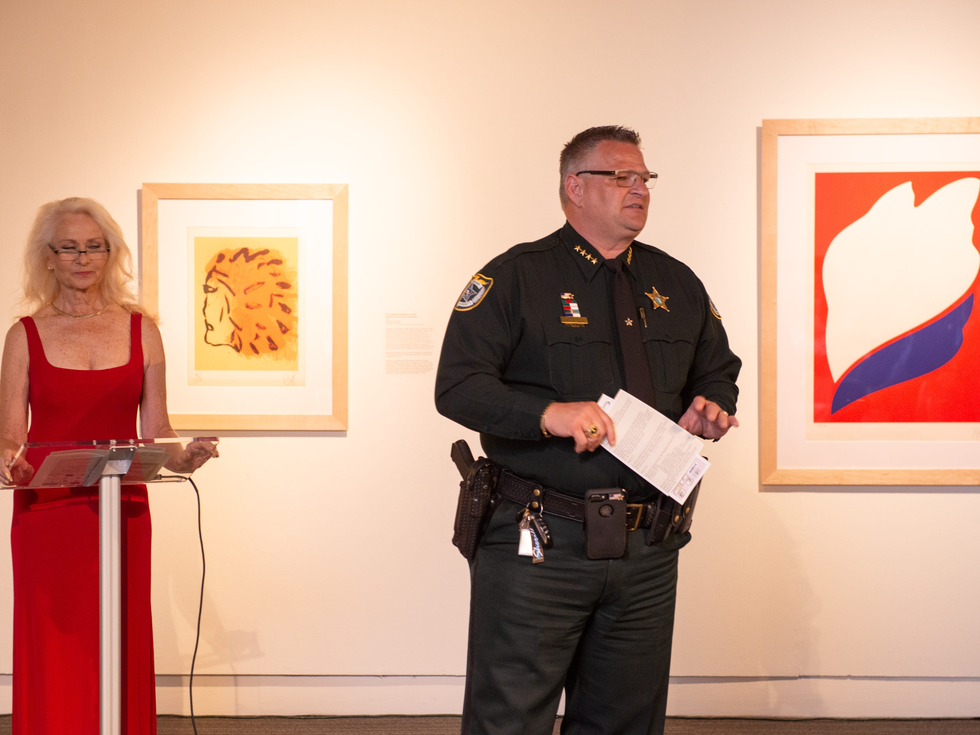 "Sheriff Wayne Ivey opens the auction during an ""Evening of Arts"" at the Foosaner Art Museum."