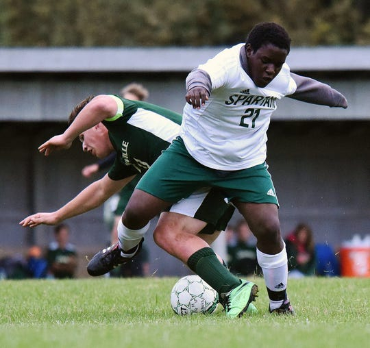 Anderson Vylzigiro makes a tackle during Winooski's win at Danville on Monday.