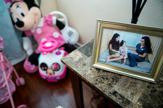 A photograph of Rosa Flores her daughter, Inez Flores, now 2, and registered nurse Andrea Ramon, is displayed in the Flores home. The  United Way of the Coastal Bend Nurse-Family Partnership program provides mothers with a free personal nurse who visits them inside their home throughout their pregnancies and until their child turns 2. Ramon has been with the family for over two years and their time is coming to an end. She is helping them wean from breastfeeding and transition Inez to her own bed.