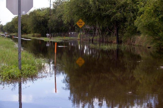 Water floods a road in the Tierra Grande colonia on Monday, October 1, 2018 from recent rains. Tierra Grande is located on the edges of Corpus Christi and Bishop in Nueces County.
