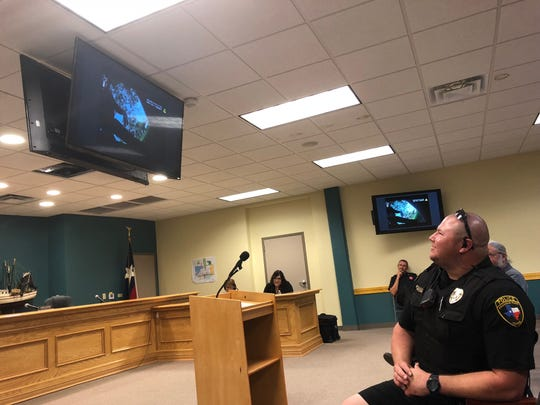 Aransas Pass Officer Jack McCarty watches body camera footage during a City Council meeting on Monday, Oct. 1, 2018.