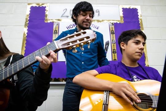 Jesse De Los Santos guitar teacher at Miller High School checks with his Metro Middle School students as they learn a  new song his first pried class on Wednesday, Sept. 26, 2018. De Los Santos is the guitarist in the local band Blind Owls.