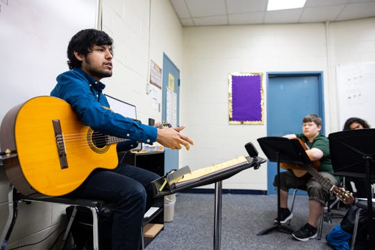Jesse De Los Santos guitar teacher at Miller High School leads his first pried class of Metro Middle School students as they learn a new song on Wednesday, Sept. 26, 2018. De Los Santos is the guitarist in the local band Blind Owls.