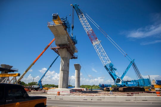 Construction crews work on the new Harbor Bridge project and assemble a crane on Tuesday, Oct. 2, 2018.