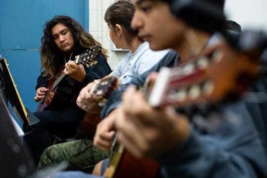 Metro Middle School students learn a new song during their class with Jesse De Los Santos, Miller High School guitar teacher at Miller High School on Wednesday, Sept. 26, 2018. De Los Santos is the guitarist in the local band Blind Owls.