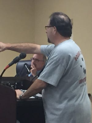 Cherry Hill resident Andrew Behrend and planning board attorney James Burns, background, squared off Monday night over the public's notification of a proposed master plan.