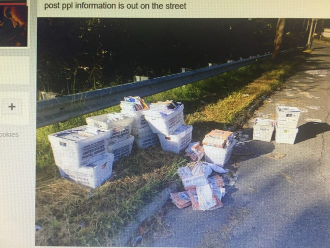 A Facebook post shows a dozen cartons of mail left on River Road in Pennsauken on Sunday.