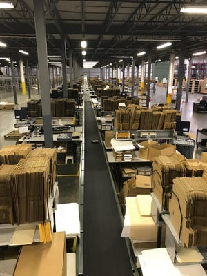 Interior of a Radial facility fulfillment center in Burlington Township, which is hiring 800 seasonal workers. Employees process, box and ship mail orders for other companies.