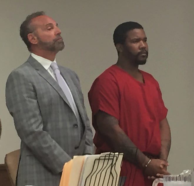Dezmenn Warren, right, and attorney Michael Kahn appear at a detention hearing Tuesday in Superior Court, Camden.