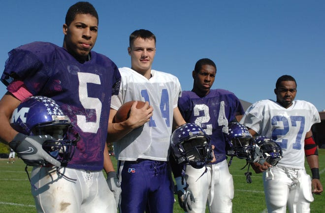Middletown High school senior football players left to right are Nick McKnight, Caleb Watkins, Jerry Gates and Antonio Banks poses for a picture during their football practice at Middletown High School Tuesday October 20, 2009 in Middletown. The Enquirer/ Joseph Fuqua II