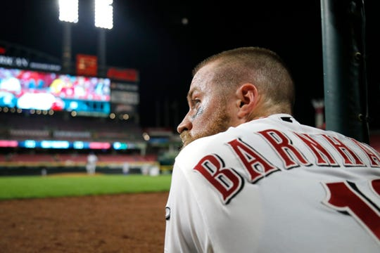 Cincinnati Reds catcher Tucker Barnhart (16) watches from the dugout in the ninth inning of the MLB Interleague game between the Cincinnati Reds and the Kansas City Royals at Great American Ball Park in downtown Cincinnati on Tuesday, Sept. 25, 2018. The Reds lost 4-3 to begin the final home stand of the season.
