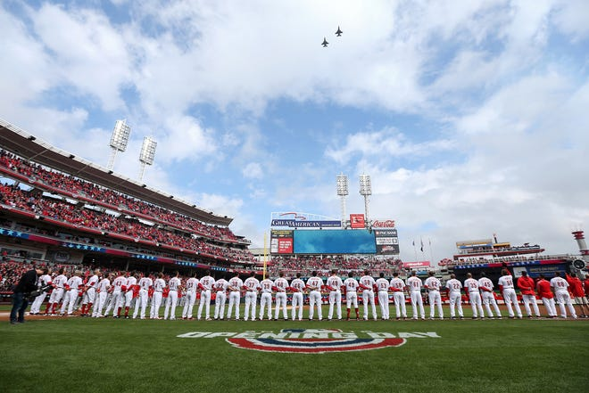 Air Force Reserve F-16 fighter jets fly over before the Opening Day National League baseball game between the Washington Nationals and the Cincinnati Reds, Friday, March 30, 2018, at Great American Ball Park in Cincinnati.