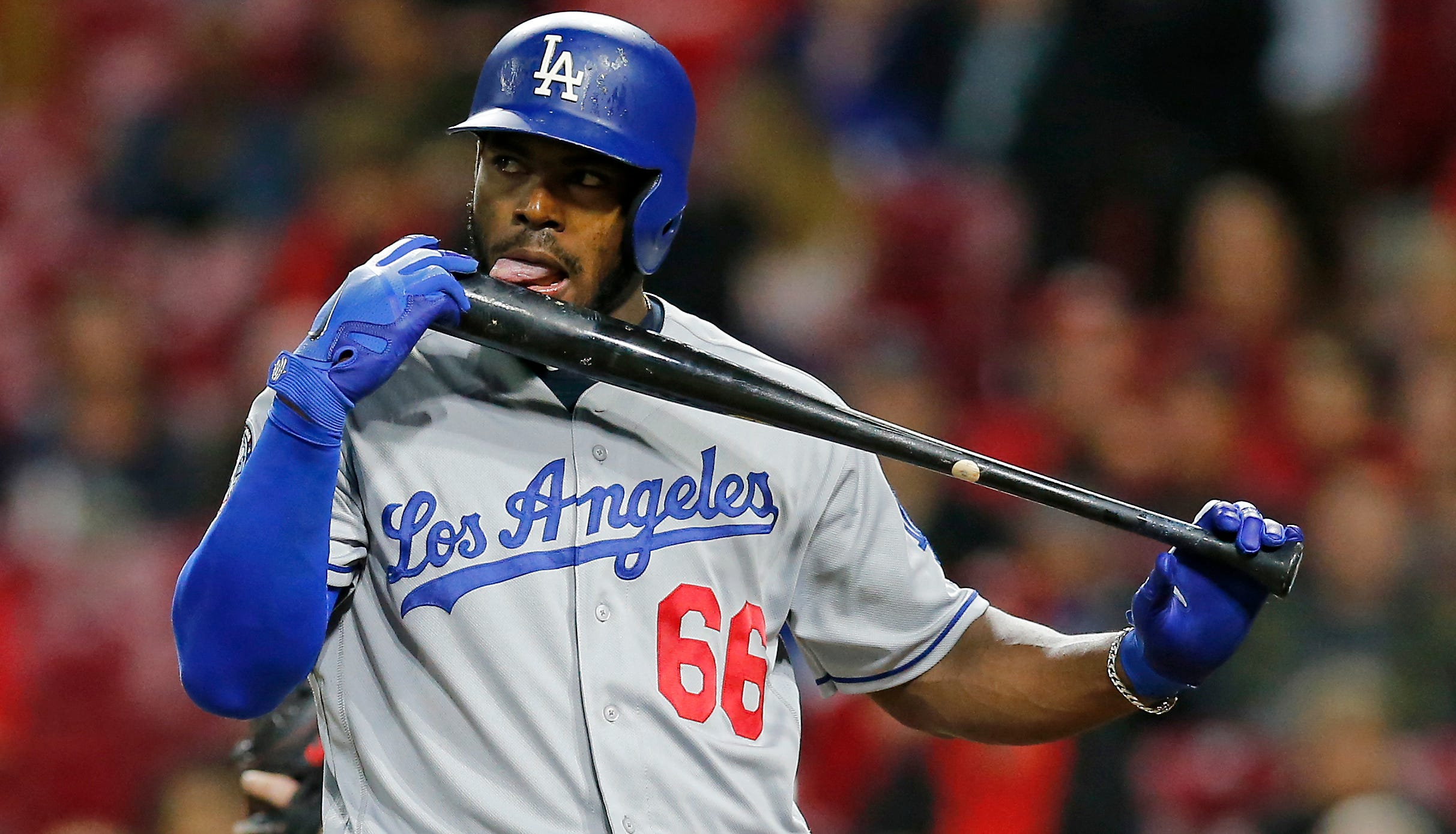 Los Angeles Dodgers right fielder Yasiel Puig (66) licks his bat after fouling off a pitch with the bases loaded in the top of the seventh inning of the MLB National League game between the Cincinnati Reds and the Los Angeles Dodgers at Great American Ball Park in downtown Cincinnati on Monday, Sept. 10, 2018. The Reds won the opening game of the series, 10-6.