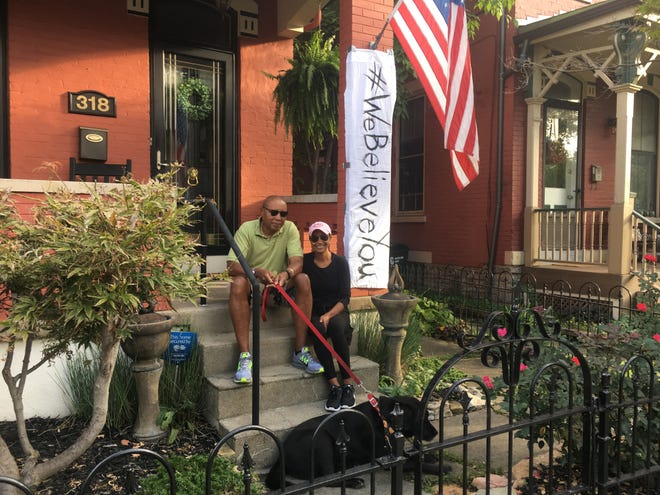Joanne Handy, right, and husband Clark Handy were one of dozens of residents in Covington, Kentucky, to hang bed sheets to show support for Christine Blasey Ford and victims of sexual assault.
