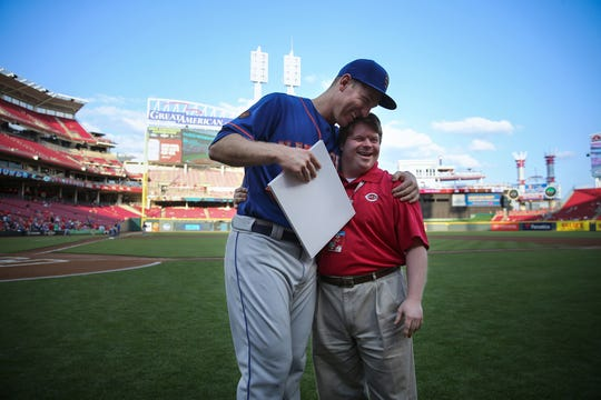 New York Mets third baseman Todd Frazier (21), formerly of the Cincinnati Reds, lefts, hugs former Cincinnati Reds bat boy Teddy Kremer before a National League baseball game between the New York Mets and the Cincinnati Reds, Monday, May 7, 2018, at Great American Ball Park in Cincinnati. Frazier played his first five seasons of his career with the Reds, earning two All-Star selections and winning the Home Run Derby in 2015. In April 2013, Frazier delivered on a promise he would hit a home run at the request of guest bat boy, Teddy Kremer.