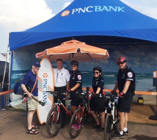 (Left to right)PNC Bank Senior Vice President of Community Relations Joe Whall, Whitehouse Rescue Squad Chief Jeff Herzog, Bryn Pfleger-Schweer, Nina Olds and Mike Stano of the Whitehouse Rescue EMS Bike Team.