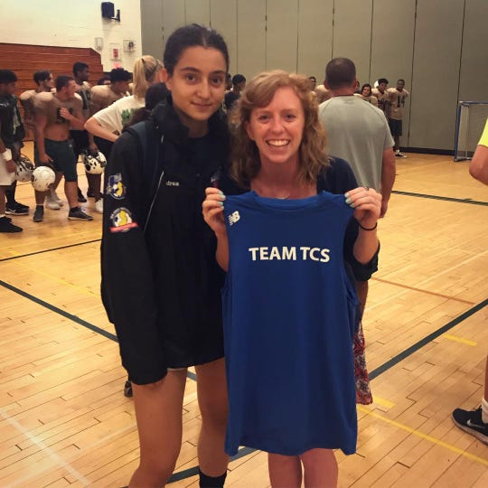 Brooke Biloholowski and her favorite soccer player, who trained with her all summer and transformed her team shirt into a tank-top.