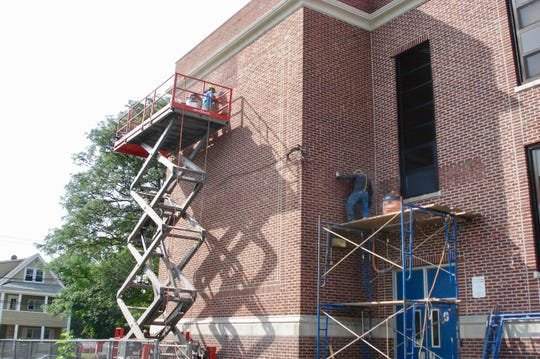 Masonry work being done at School No. 6.