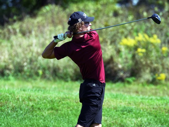 Jack Williams, of John Glenn, hits a drive during the Division II district golf tournament on Monday at EagleSticks.