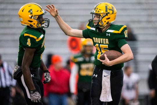 Des Moines Hoover's Gabe Banks and Jerad Fischer celebrate after winning their first game of the season against Des Moines North on Monday, Oct. 1, 2018, in Des Moines. The game was cut short several weeks ago after shots were fired in a parking lot near by. Hoover won the game 21-18.
