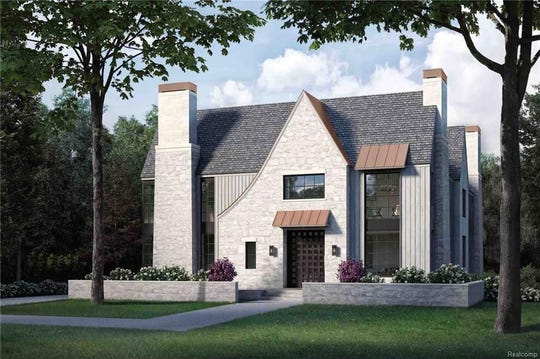 This new construction home in Birmingham has 5  bedroom suites, a 3-car side-entry garage, a loggia, a wine room and an elevator.