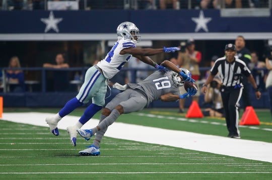 Detroit Lions receiver Kenny Golladay catches a pass as Dallas Cowboys cornerback Chidobe Awuzie defends in the second half in Arlington, Texas, Sunday, Sept. 30, 2018.