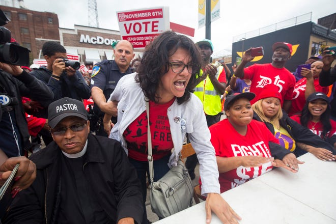 Congressional candidate Rashida Tlaib joins 'Fight For $15' and striking McDonalds employees, as she is arrested in front of McDonalds on Woodward Avenue on Tuesday, Oct. 2, 2018 during a protest.