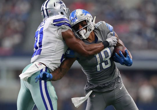 Dallas Cowboys' Byron Jones tries to tackle Detroit Lions' Kenny Golladay in the fourth quarter at AT&T Stadium on Sept. 30, 2018 in Arlington, Texas.