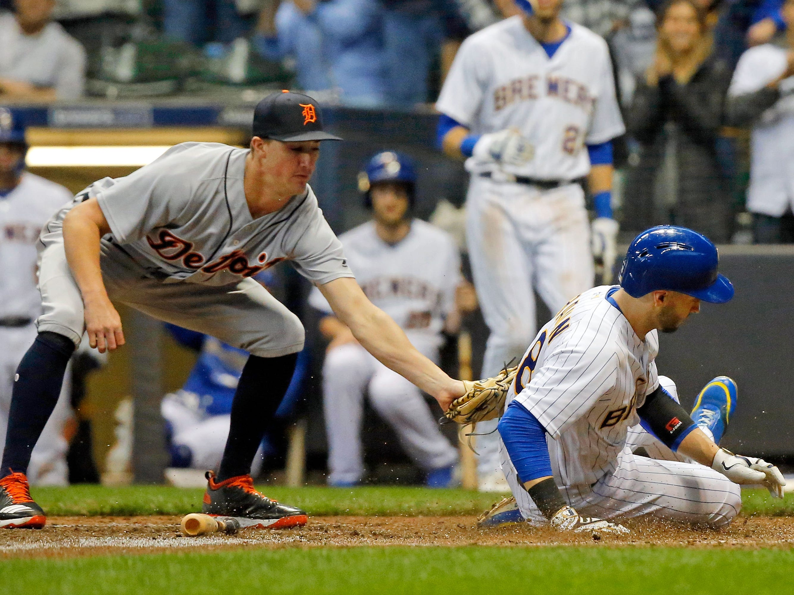 Milwaukee Brewers' Ryan Braun slides safely into home as Detroit Tigers reliever Zac Reininger applies the late tag to during the seventh inning on Sept. 30, 2018 in Milwaukee.