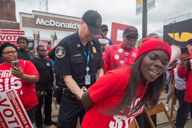 Brittany Williamson, 24, of Detroit, a member of Fight For $15 and striking McDonalds employee, is arrested in front of McDonalds on Woodward Avenue on Tuesday, Oct. 2, 2018.