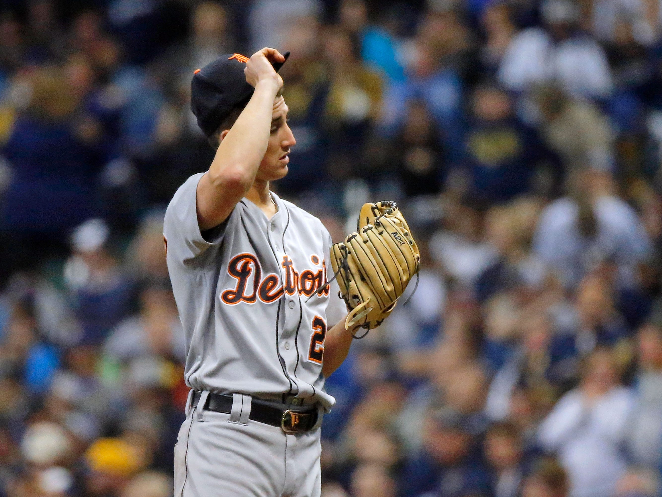 Detroit Tigers' Zac Reininger reacts after giving up a double to the Milwaukee Brewers during the seventh inning at Miller Park on Sept. 30, 2018.