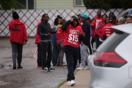 Protesters remain on scene as Flint Police officers investigate a scene where six people were hit by a truck during a 'Fight for $15' rally in Flint early Tuesday, October 2, 2018 along Dort Highway. The truck reportedly also hit a Consumers Energy Vehicle.