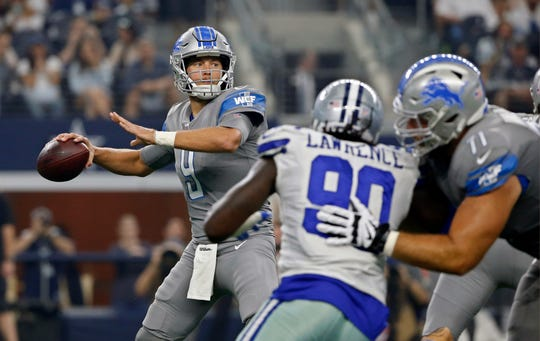 Detroit Lions quarterback Matthew Stafford throws under pressure from Dallas Cowboys defensive end Demarcus Lawrence in the first half in Arlington, Texas, Sunday, Sept. 30, 2018.