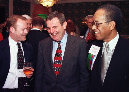 Jack Smith, chairman of GM, center, laughs as he talks with Jeremy Burne, left, vice consul of the British Consulate in Cleveland, and Bill Brooks at the Grand Hotel on Mackinac Island in May 1997. Brooks is the VP of corporate affairs at GM and the incoming chairman of the chamber.