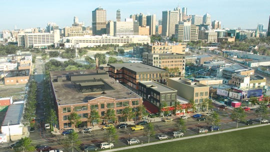 A aerial rendering of the Elton Park design shows the remodeled Checker Cab building in the lower left along Trumbull.  Elton Park is envisioned as a 24-hour residential and commercial district within Corktown.