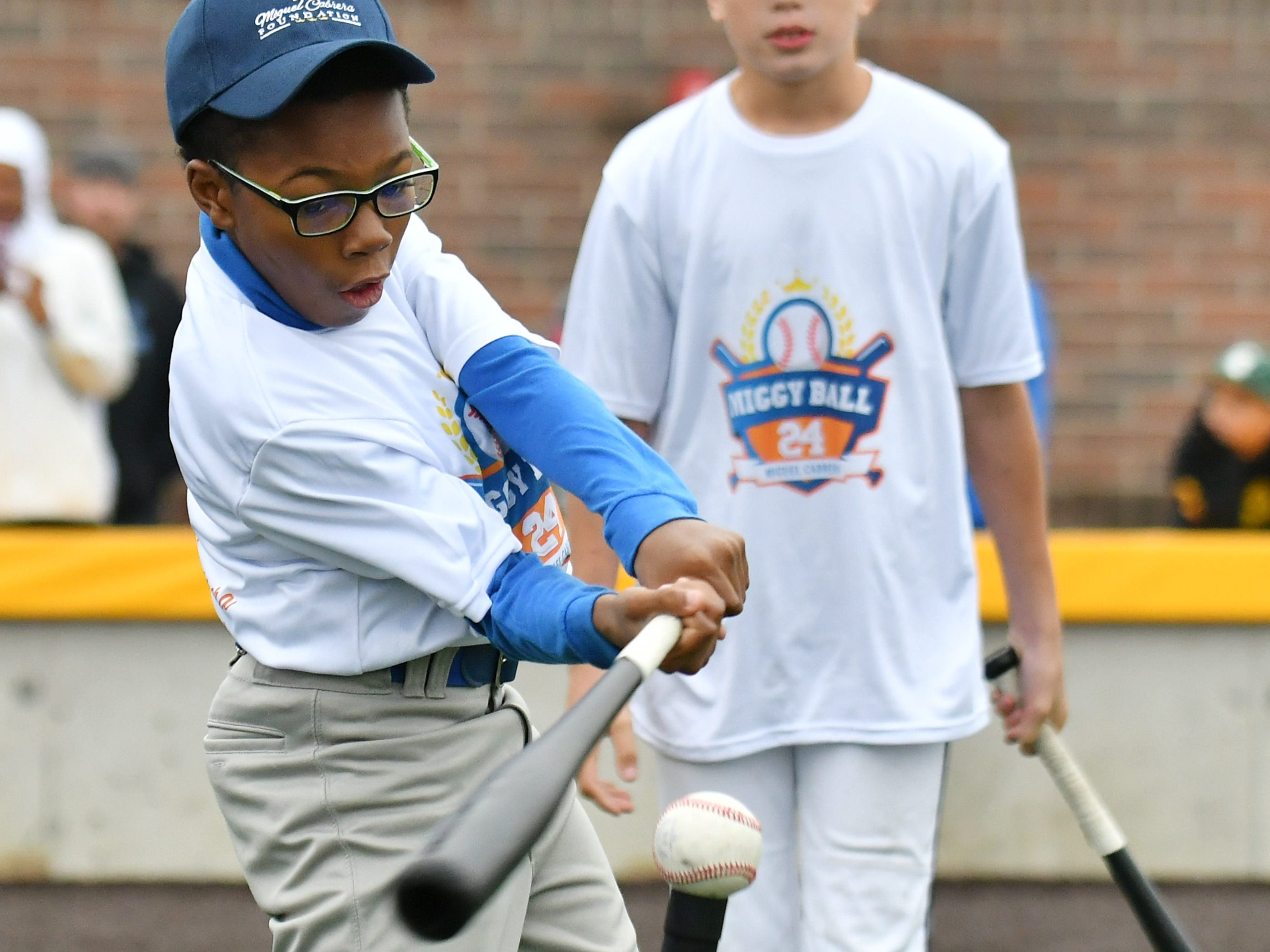 Jermaine Rodgers, 10, of Detroit hits the ball off a tee.