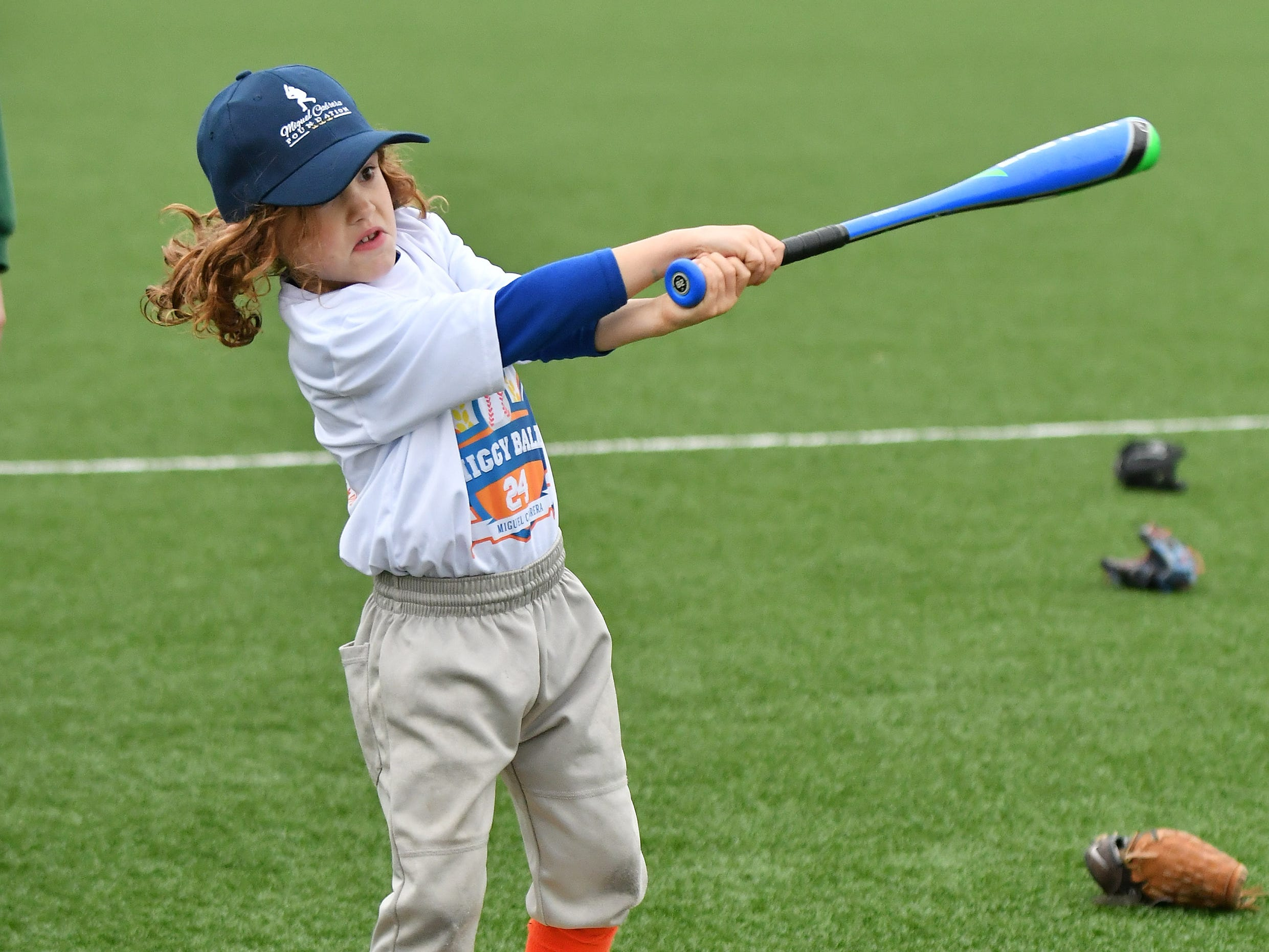 Isaac Gourley, 6, of Detroit keeps his balance while swinging the bat.